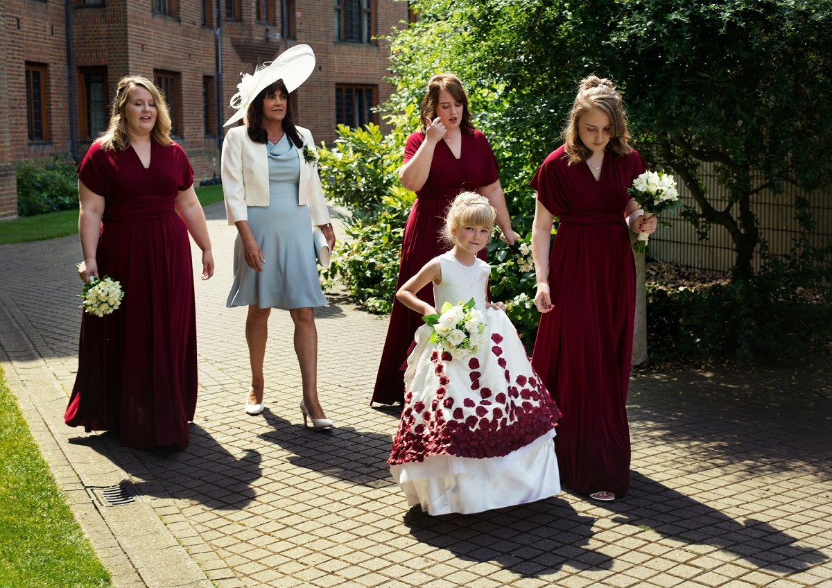 flower girl and bridesmaids are going to the chapel