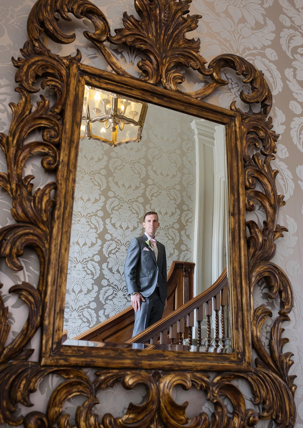portrait of groom in mirror