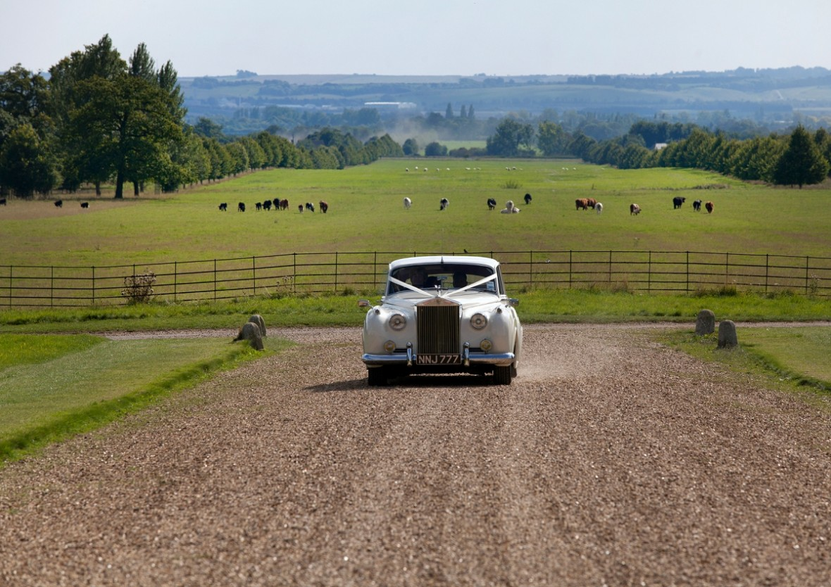 White Rolls Royce arrives at Wimpole Hall